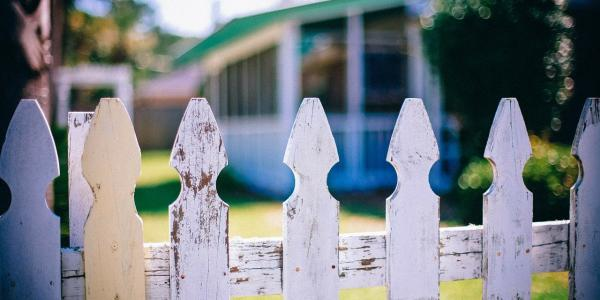 Picket Fence in front of home